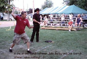Knife Throwing contest between Joe Darrah and John Bailey